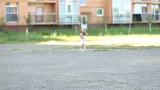 little girl runs bouncing around