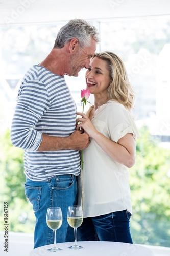 Zdjęcia na płótnie, fototapety, obrazy : Romantic mature couple with pink rose