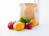 close up of paper bag with vegetables at kitchen