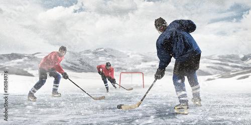 obraz PCV Playing hockey game . Mixed media