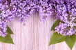 Beautiful lilac flowers on wooden  surface