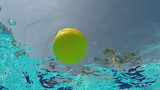 ball floating in a pool