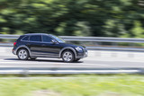 car in fast motion with panning effect on highway