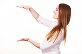 Woman uses hands to indicate area of frame, copy space for product