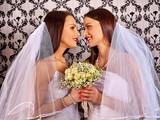 Wedding lesbians girl in bridal dress. lesbians keeps flower. Wallpaper background.