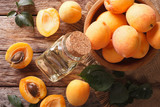 """Healthy apricot oil in a glass bottle macro. Horizontal top view 99459992,emale eye zone and brows with day makeup"""""""