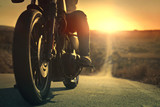 On a roaring motorcycle at sunset - 116228976