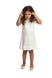 Cute little girl making an angry expression pointing finger