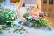 Hands of florist woman creating bouquets for wedding decoration