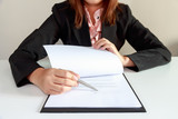 businesswoman pointing a place where should sign the contract