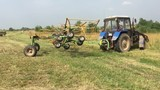 Сельскохозяйственные машины на заготовке сена для коров