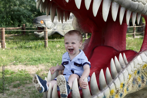 Poster Boy in jaws of dinosaur