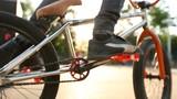 Closeup of rider feet pedaling his bmx in skatepark