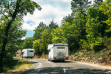 Motorhome Car Goes On Road On Background Of French Mountain Natu