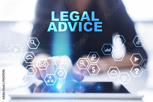 "Woman is using tablet pc, pressing on virtual screen and select ""Legal advice""."