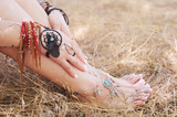 Handcrafted bracelets on a woman legs and hands, dreamcatcher jewelry