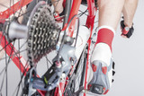 Sport Cycling Concepts. Back View of the Athlete Leg Inline with Cassette Sprocket