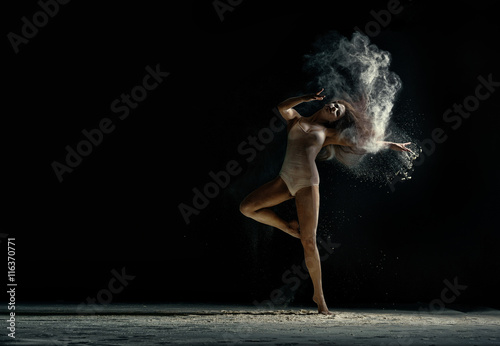 Amazing photo of graceful woman dancing with dust Poster