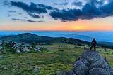 Black Peak (Cherni Vrah) on Vitosha mountain, Bulgaria - 2290 m - person enjoying the sunset