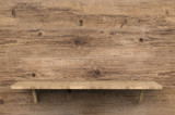 wooden shelf on wooden background