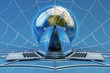 Global computer network connection, online communication and internet technology concept, modern laptops and Earth globe on blue background with spider web