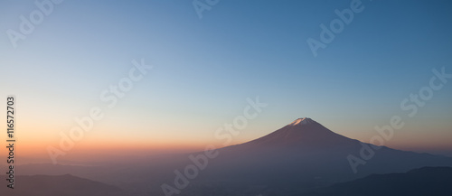 Fototapeta Top of mountain Fuji and sunrise sky in autumn season