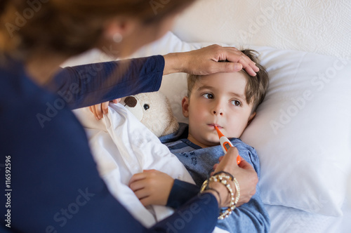 Fotografiet Boy measuring fever