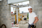 portrait of handsome construction worker on a building industry construction site - 116594743