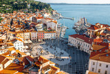 Beautiful aerial view on Piran town with Tartini main square, ancient buildings with red roofs and Adriatic sea in southwestern Slovenia - 116621186