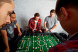 Young friends,students having fun together playing table football