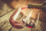 Pouring wine in a glass - 116644788
