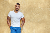 Outdoor fashion portrait of young handsome man in white t-shirt