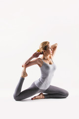 Beautiful young woman doing yoga. Isolated on white © milazvereva