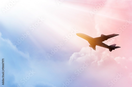 mata magnetyczna Airplane in the sky and colorful clouds in sunset