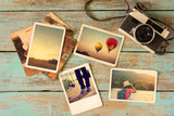 Photo album remembrance and nostalgia in summer journey trip on wood table. instant photo of vintage camera - vintage and retro style - 116671774