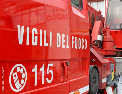 Poster big words VIGILI DEL FUOCO meaning firefighters on red firetruck