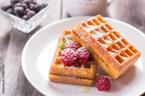 Poster Belgian waffles with raspberry, honey and sprinkled with powdere