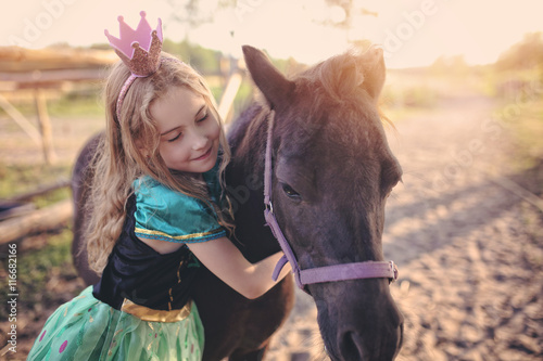 Young princess on a pony
