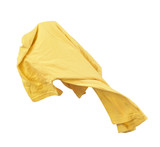 Blank yellow shirt are falling through the air on an isolated wh