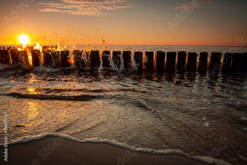 Fototapety, obrazy : Sunset at Baltic sea, view on old breakwater piles.