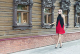 An outdoor fashion gothic style portrait of a beautiful blonde girl