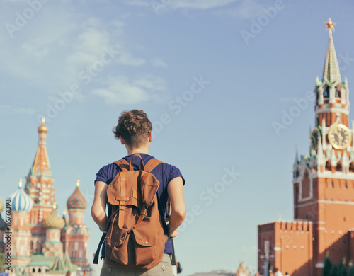 Fotobehang Moskou Young attractive woman traveler with backpack on the background