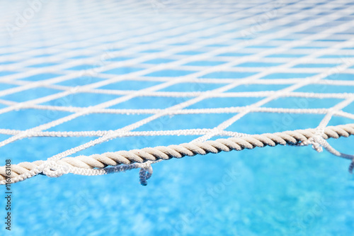 small pool of a cruise ship covered by a protective net - 116763108