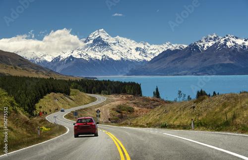Keuken foto achterwand Nieuw Zeeland Red car on the road to Mt.Cook,New Zealand