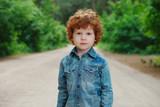 cute little emotional boy outdoors