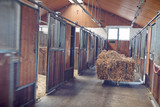 Bales of hay in a stable block - 116785964