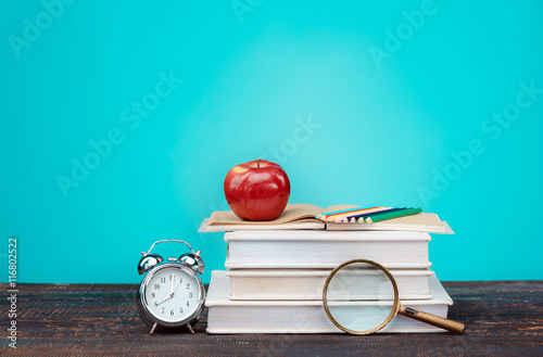 Poster Back to School concept. Books, colored pencils and clock