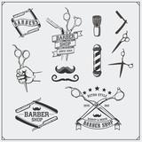Set of vintage Barber shop design elements, labels, badges and emblems.