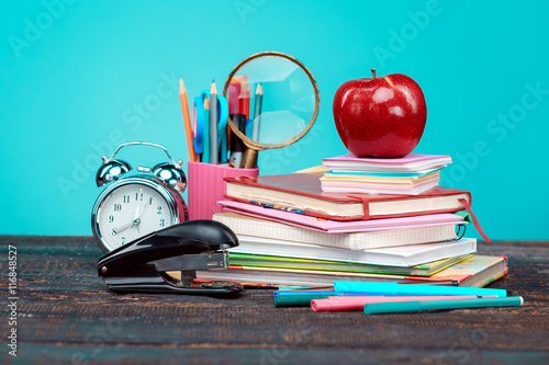 Back to School concept. Books, colored pencils and clock плакат
