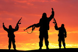 Silhouette of military soldier, shot, holding gun, colorful sky, Concept of a terrorist.  Silhouette terrorists with rifle, sunset on background